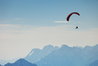 Austria, Tyrol, Paraglider flying over mountains