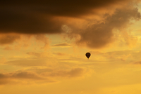 Sweden, Stockholm, Silhouette of hot air balloon in evening sky