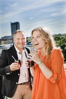 Sweden, Uppland, Stockholm, Portrait of couple drinking cocktails
