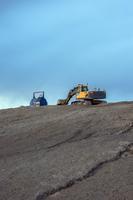 Finland, Pohjanmaa, Pietarsaari, Bulldozer on rocky surface