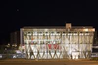 Sweden, Vasterbotten, Umea, Glass office building at night
