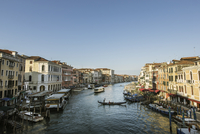 Italy, Venice, Canal in city with gondolas and boats
