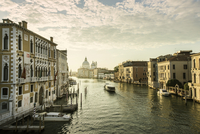 Italy, Venice, Canal in city at sunrise
