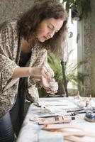 Sweden, Mature woman preparing decorations
