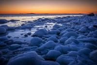 Sweden, Sodermanland, Toro, Frozen coast at sunset