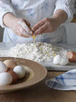 Sweden, Woman making pasta dough