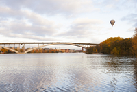 Sweden, Stockholm, Hot air balloon above arch bridge