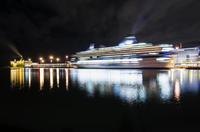 Finland, Helsinki, Illuminated passenger ship in harbor