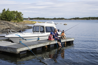 Finland, Aboland, Hitis, Woman with two kids fishing in lake