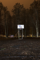 Finland, Nyland, Helsinki, Drumso, Basketball ring in park at night