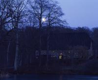 Sweden, Skane, Bokskogen, Single house at night