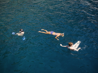 Turkey, Mugla, Marmaris, Elevated view of people swimming in sea
