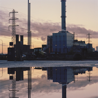 Sweden, Skane, Malmo, Ostra Hamnen, Industrial buildings at sunset