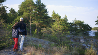 Sweden, Sodermanland, Stockholm Archipelago, Rear view of teenage girl (16-17) and young man walking