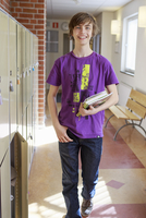 Sweden, Teenage boy (14-15) walking on school corridor