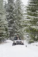 Sweden, Vastmanland, Bergslagen, Hallefors, Silvergruvan, Mature man driving snow blower