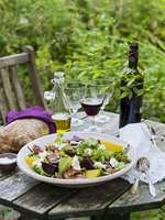 Sweden, Goat cheese salad, bread, olive oil, salt, cutlery and wine on table 11090018543| 写真素材・ストックフォト・画像・イラスト素材|アマナイメージズ