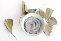 Organic herbal cream mask with ginkgo leaves