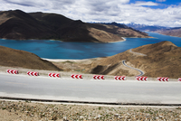 Road and Yamdrok Yamtso lake in Tibet, China