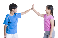 Happy children giving high-five