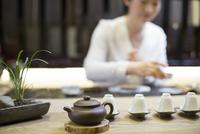 Mid adult woman performing tea ceremony