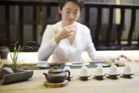 Mid adult woman performing tea ceremony