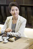 Businesswoman drinking tea in tea room