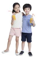 Happy children drinking juice