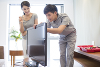 Engineer repairing television in customer's home