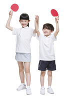 Cute children playing table tennis