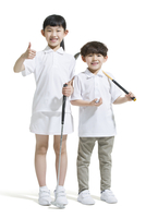 Cute children playing golf