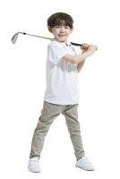 Cute boy playing golf