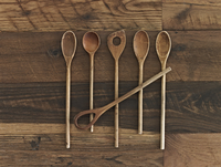 An arrangement of six wooden spoons