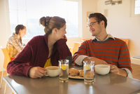 Man and a young woman sitting in a coffee shop.