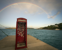 Rainbow over a red phone booth standing on a jetty by the sea. 11093005738| 写真素材・ストックフォト・画像・イラスト素材|アマナイメージズ