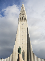 Hallgrimskirkja church, a tall modern church tower and statue of the explorer Leif Erickson.