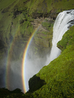 Skogafoss waterfall with a double rainbow in the mist and vapour rising from the water.  11093006753| 写真素材・ストックフォト・画像・イラスト素材|アマナイメージズ