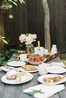 Breakfast table with tea, pastries and fresh strawberries.