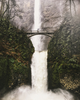 Footbridge across a waterfall at Multnomah Falls in Oregon, USA.