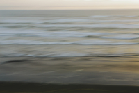 Blurred motion abstract of the Pacific Ocean at dusk.