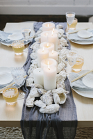 Place settings at a table dressed for an occasion.