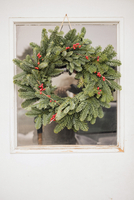 A Christmas wreath on a door.