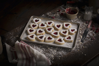 Valentine's Day baking, high angle view of a baking tray with heart shaped biscuits.