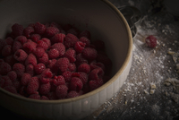 Valentine's Day baking.  High angle view of a bowl of fresh raspberries.