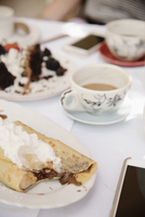 Close up of food and drink on a table, a hot drink, cake and pancake with cream. 11093010559| 写真素材・ストックフォト・画像・イラスト素材|アマナイメージズ