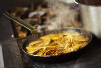 Close up of a tarte tatin in a frying pan.