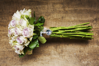 A wedding bouquet, a flower arrangement of long stemmed pink roses.