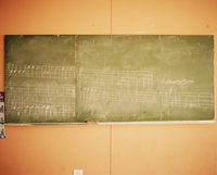 Music written on a blackboard in a school classroom.