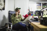 Design Studio. A man sitting at a desk making a phone call.