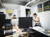 Design Studio. A man and woman in an office.